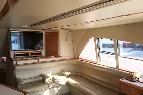 Image of lounge and TV inside the Kaizen 52 cabin