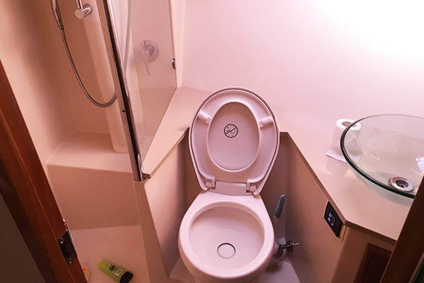 Image of toilet and shower on the Kaizen 52 fishing vessel